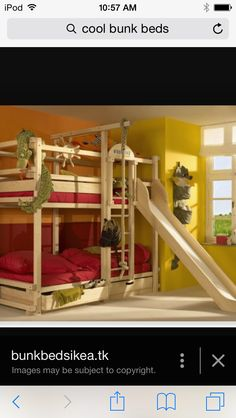 A bunk bed with a slide and a swing rope