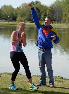 Description of . Justin Horner  gives the thumbs up as Cali Leopold says yes after he proposed to her after she finished her 1/2 marathon run in the 9th annual Colfax Marathon May 18, 2014. The 26.2 mile Marathon runs through Denver's iconic landmark Mile High Stadium (twice), Sloan's Lake, City Park, Colfax Avenue through Lakewood and Aurora. The Marathon started and finished in City Park where runners enjoyed the rest of the day listening to music by Chris Daniels and the Kings. (Photo by…