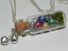 Christmas Ornaments Bottle Necklace, Miniature Christmas Ornaments in a Bottle. $25.00, via Etsy.