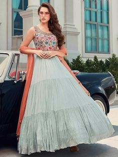 Breathtaking multicolor embroidered gown online at best shopping price. Shop this latest gown style for diwali celebration. This alluring style set comprises a georgette gown with matching net dupatta. Designer Wedding Gowns, Designer Gowns, Designer Wear, Abaya Fashion, Grey Fashion, Fashion Outfits, Salwar Kameez, Kurti, Party Wear Long Gowns