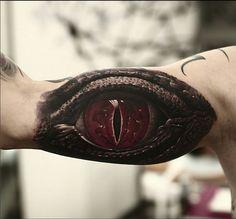 Arm eye tattoo
