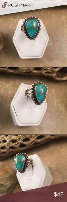 Vintage Navajo Turquoise & Sterling Silver Ring 7 Authentic vintage Navajo Sterling silver & Natural Turquoise Ring size 7. This ring is in excellent condition. The length is 3/4 of an inch long and 5/8 of an inch wide. This piece is signed by the artist. Jewelry Rings