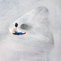 Numen/ For Use - For Use used thick transparent sticky tape to create an interactive installation. By stretching, sticking and wrapping thick layers of tape around grounded pillars, beams, trees or whatever standing objects exist in the chosen space Numen/ For Use create a web of tendon tunnels and spaces that can be accessed and crawled through, strong enough to carry human weight. From afar the installation appears like an interwoven structure of bending elastic pipes.