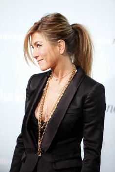 Ponytail with mini pouff/bump at back. Can be casual, can be chic - Jennifer Aniston