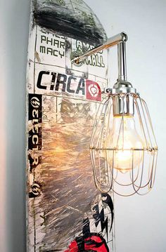 Skateboard Sconce Lamp by MFEO ~ could be done with anything, ex: vintage washboard, surfboard, salvaged architectural wood, etc.