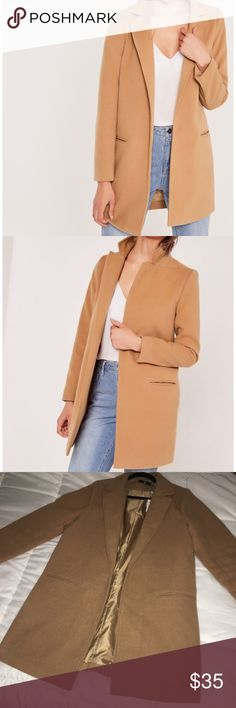 MISGUIDED SHORT FAUX WOOL COAT SZ US 12 fits US 10 Tailored camel coat with 2 front pocket detail, this beautiful, stylish jacket hits about mid-thigh. This jacket does say US sz 12, but fits close to US sz 10. This jacket is in excellent condition with tags attached. Missguided Jackets & Coats Pea Coats