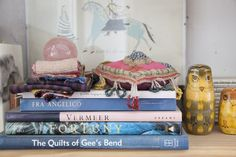 Worldly textiles styled on books // Coral & Tusk Studio Tour