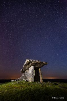 'The Portal and the Cosmos', Poulnabrone portal tomb in the Burren, County Clare, Ireland. It dates back to the Neolithic period. Photo by Bryan Hanna.
