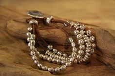 Google Image Result for http://www.sawitfirst.co.uk/media/Tan_leather_silver_beaded_bracelet_lrg.jpg