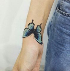 Black and blue butterfly on wrist.