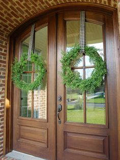 hang wreath with ribbon stapled to top of door