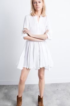 Zadig & Voltaire long sleeve dress, Mandarin collar with embroidered detailing, skirt cut on the bias, raw edges finish, drawstring waist, skill beads and tassels, 100% cotton.