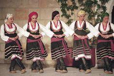 Photograph:Greek women perform a folk dance. Greek Dancing, Greek Traditional Dress, Cultural Dance, Art Populaire, Greek Culture, Folk Dance, Dance Costumes, Greek Costumes, Dance Photos