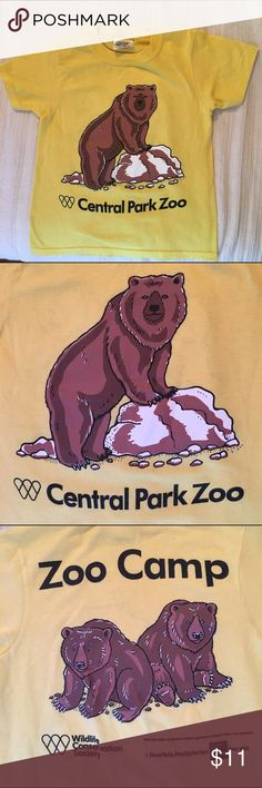 NYC Central Park zoo tshirt This adorable tshirt was worn only twice. I had bought two, so hoping to find a good home for this one! It is in great condition and is a one of a kind and not available to the general public. For any boy or girl who loves animals, the perfect little tshirt. Size says xs. Shirts & Tops Tees - Short Sleeve