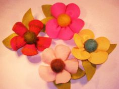These flowers are great for hair clips or gift packages.  I put buttons in the middle of mine instead of the felted balls, but I got this awesome idea from Judy.  She has a lot of great ideas on her web-blog.