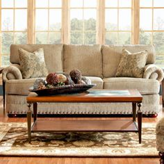Sofa+with+nailhead+trim+and+bun+feet.+Made+in+the+USA.    +  Product:+Sofa++Construction+Material:+Wood+and+fabri...