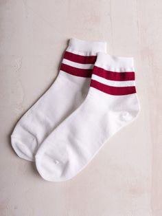 Rib knit crew socks with varsity stripe detail. One Size Fits Most 90% Cotton, 10% Spandex