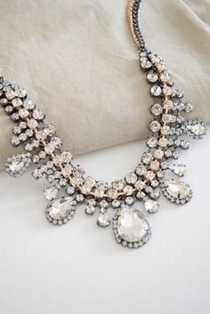 Vintage inspired, gorgeous drop shaped glass crystals statement necklace. Chain is mixed plated gold and gunmetal. This necklace is made with beautiful glass rhinestones, very lightweight, flexible, a