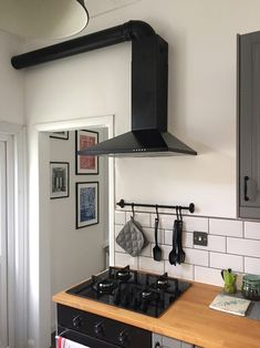 Kitchen idea cast iron down pipe gutter used as extractor hood pipe