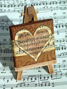 Well, the artistic miniature painting ideas listed in this article are intricate and delicate brushwork which lends them a unique identity, these paintings Sheet Music Crafts, Sheet Music Art, Vintage Sheet Music, Music Sheets, Altered Canvas, Altered Art, Canvas Crafts, Diy Canvas, Music Canvas