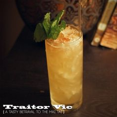 Traitor Vic 2 parts spiced dark rum [ Captain Morgan 100 proof ] 1 part fresh lime juice 1/2 part ginger liquor [ Domaine de Canton ] 1/2 part orgeat [ if you can make your own, you're my hero ] orange bitters [ Scrappy's Bitters ] mint sprig