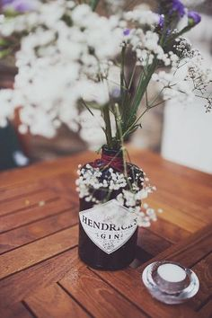 Image result for gin bottle flower decorations