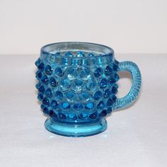 Hey, I found this really awesome Etsy listing at https://www.etsy.com/listing/210916158/vintage-blue-hobnail-glass-mug-childs