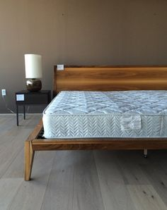 "Huppe Moment King Bed Original Price: $2945 Material(s): Solid American black walnut, American black walnut veneer\ Floor model never been owned.  Dimensions: 87""W X 87.75""D X 37""H"