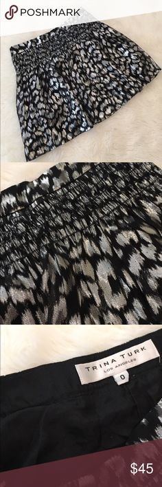 "Trina Turk silver and black metallic skirt size 0 Trina Turk Silver and Black Metallic skirt. Size 0. EUC. Side zip. Approx 16.5"" in length lying flat. So flattering! Trina Turk Skirts"