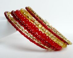 Memory wire bracelet. Red and gold seed beads. Very pretty. Wrap bracelet