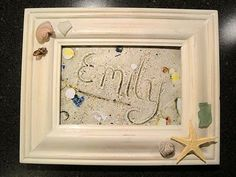 Sand name art (or message) at the beach, take pictures, print, frame and glue shells to frame.  I'm wondering if I can glue some sand too.
