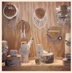 Natural jewelry display - one color collection makes such an impact and the consistent use of logs for props pulls the space together.