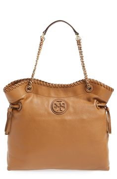 Such a great bag to travel with. Love this Tory Burch 'Marion' leather tote.