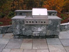 Natural Cleft Bluestone Patio Creates A Great Base For This Outdor Grill  With Natural Stone Veneer
