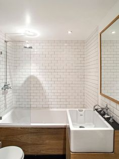 Contemporary Full Bathroom with Farmhouse Sink, Hammersmith Subway Tile in White, Flush, Drop-In Bathtub, slate tile floors