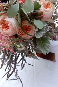 Juliette David Austin Garden roses, Dusty Miller, feathery dark Agonis leaves, Celosia Specata, Black Scabbiossa blossoms with their pods, Astilbe, Fuschias and Seeded Eucalyptus with foliag