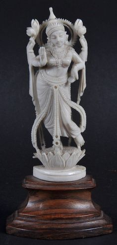 An Early 20th Century Indian Carved Ivory Figure of a Female Modelled standing Upon a Lotus Base. Ivory Measures 3 1/4 Inches in Height