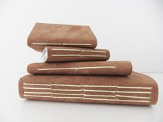 Set of 4 handmade suede leather journals  £15.00 by Peony and Thistle