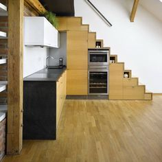 Looking for under stair storage ideas for small space living.  Tons of pictures. Love the idea of incorporating the stairway into the kitchen for additional cupboard space.