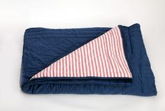 Kids Reversible Quilt Bed Cover, Navy with Red and White Stripes, King Size: This reversible quilt adds a shot of colour with its red and white striped backing against a navy blue front. Rs. 15,120
