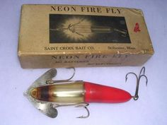 """Most Likely to Annoy Greenpeace  The Neon Fire Fly, made in the 1930s by St. Croix Bait Co., Stillwater, Minnesota, had a clear nose filled with 1.5 ounces of liquid mercury to make the lure """"glow."""" Wow!"""