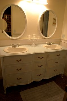 Dresser turned into a double sink vanity by Keri Gwynn and husband...what a great way to turn a $45 find into a beautiful piece of furniture.  Inspires me to want to find ways to repurpose old furniture.