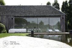 Glasshouse® met binnenzwembad en design tuinmeubilair, Ludo Dierckx tuindesign ontwerp