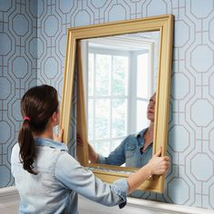 Just because you don't like the builder basic mirror in your bathroom doesn't mean you have to get rid of it. Build a frame from crown moulding so it looks more polished! #repurposed #DIY