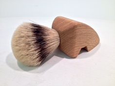 Hand made oak handled shaving brush with silvertip badger hair knot