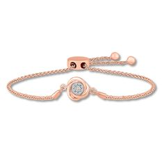 This pretty bolo bracelet from the Forever Knots collection features an endless knot sparkling with round diamonds in the center. Fashioned in 10K rose gold, the bracelet has wheat chain sides that slide easily through the adjustable bolo clasp for lengths up to 9 inches. The bracelet has a total diamond weight of 1/6 carat. Diamond Total Carat Weight may range from .145 - .17 carats.