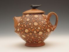 tea from a kettle. love the whistle and gurgles. and this teapot is really spiffy. i kind of want it.