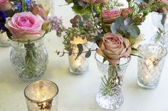 not for flowers or set-up but showing the examples of cut glass bud vases with mercury votives for the lesser expensive centerpiece option instead of the ivory urn florals Vase Centerpieces, Vases Decor, Bud Vases, Flower Vases, Wedding Vases, Wedding Table, Wedding Flowers, Small Glass Vases, Cut Glass Vase