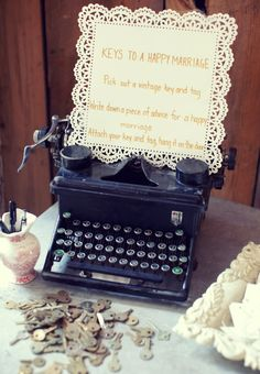 """""""Keys"""" to a happy marriage (you write your advice on a tag & attach it to an old key).  Love the typewriter display too!  :-)"""