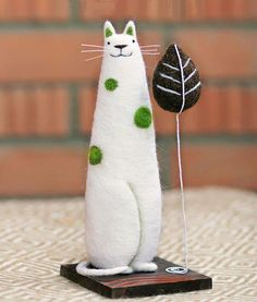 white cat with green spots
